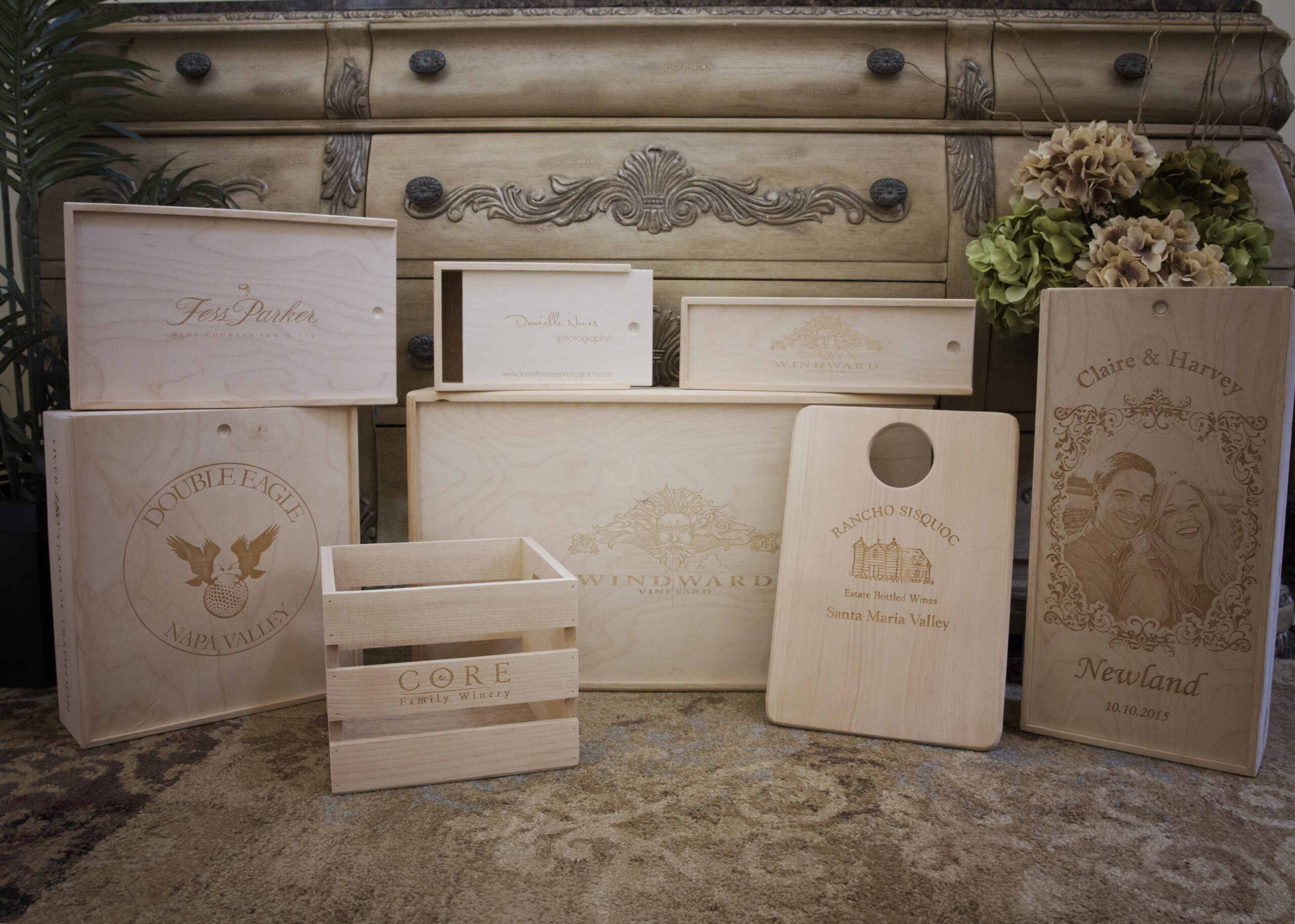 Assorted wooden wine crates with laser etching
